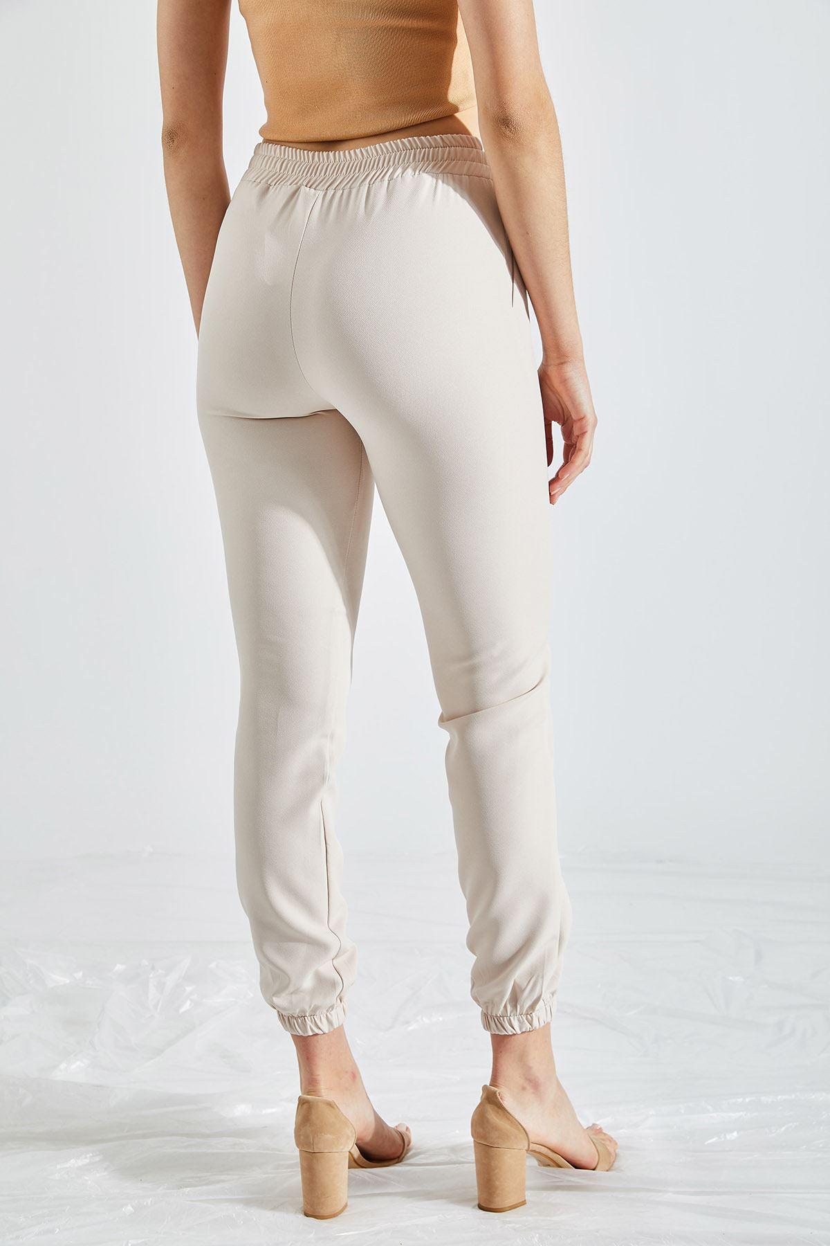 Kadın Bel Ve Paça Lastikli Taş Kumaş Pantolon